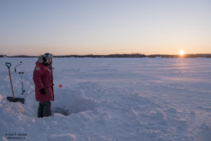 Ice Fishing at Sunset