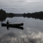 Canoe reflections in Algonquin Park